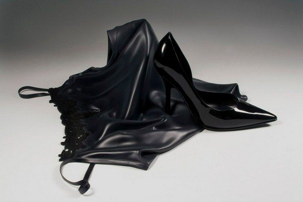 A perfect looking black dress fabric and a shoe.